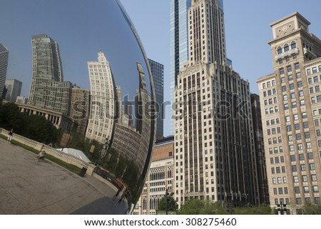 CHICAGO,IL/USA - JULY 5: Cloud Gate as  in July 5 2015 in Chicago, IL. Cloud Gate or the Bean is one of the main attractions of  of Millennium Park in the Loop Area of Chicago. - stock photo
