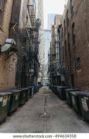 Chicago, IL, USA â?? September 25, 2015: Garbage cans stand between buildings in a courtyard of Chicago.