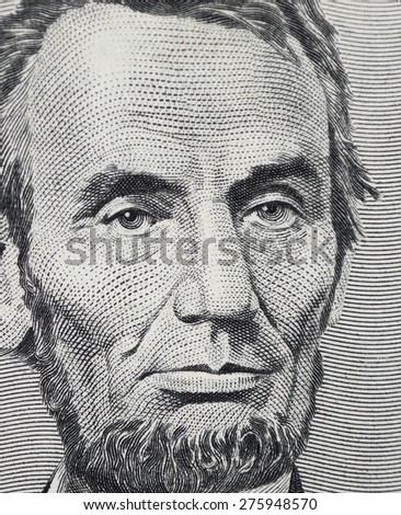 CHICAGO, ILLINOIS - APRIL 29, 2015. Macro shot of Abraham Lincoln the Five Dollar Currency banknote