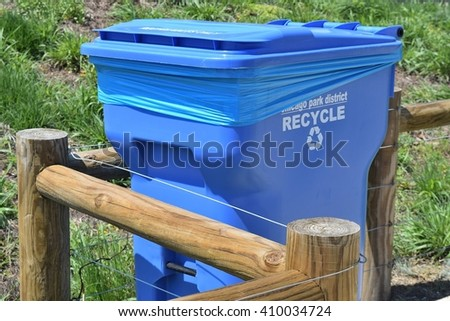 CHICAGO, ILLINOIS - APRIL 23, 2016: Near north side recycle cart next to environmental wood ECO fence.  - stock photo