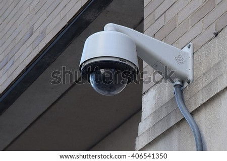 CHICAGO, ILLINOIS - APRIL 15, 2016: Security CCTV camera scans entrance to medical parking lot complex on near north side.