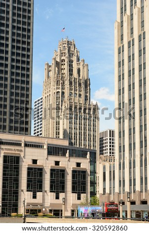 CHICAGO, ILLINOIS - AUGUST 22, 2015: Tribune Tower. The Gothic style building is seen between some of the more modern architecture in Downtown Chicago. - stock photo