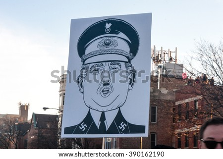 Chicago, ILLINOIS - MARCH 11, 2016: Protest sign depicts Donald Trump as Nazi at Anti-Trump demonstration outside the University of Illinois at Chicago Pavilion. - stock photo