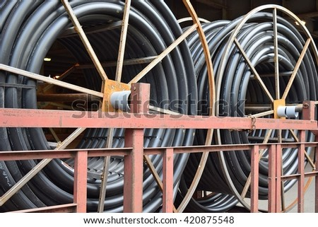 CHICAGO, ILLINOIS - MAY 15, 2016: Copper data and power cable spools parked under lower Wacker Drive by new high rise construction site.