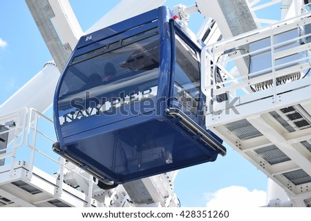 CHICAGO, ILLINOIS - MAY 29: Gondolas move passengers of the newly opened Dutch Ferris Wheel  in near east side by Navy Pier on May 29, 2016. .