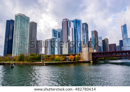 CHICAGO, ILLINOIS - OCTOBER 15, 2012 -     City of Chicago. Image of Chicago downtown and Chicago River with bridges during sunset.