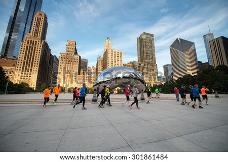 CHICAGO, ILLINOIS - OCTOBER 9: Cloud Gate (The Bean) on October 6, 2012 in Chicago, Illinois. Chicago Cloud Gate sculpture and downtown Chicago skyline buildings in Millenium Park at early morning - stock photo