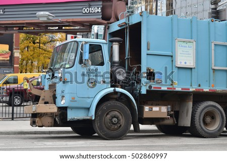 CHICAGO, ILLINOIS - OCTOBER 22: Energy efficient City of Chicago Streets and Sanitation garbage truck parks while crew is on lunch break on October 22, 2016 in near north side.
