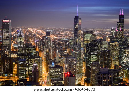 CHICAGO, ILLINOIS - OCTOBER 14, 2013 -  skyline at night in the city of chicago usa with illuminated skyscrapers