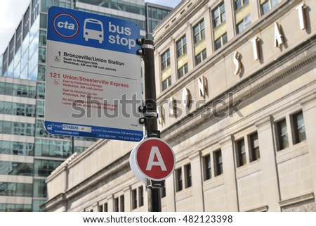 CHICAGO, ILLINOIS - SEPTEMBER 10: CTA bus stop sign routes 1 and 21 advises commuter passenger of bus route next to the Amtrak Union Station transit terminal on September 10, 2016 in near north side.