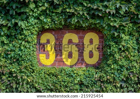 CHICAGO, ILLINOIS - SEPTEMBER 8: 368 feet sign on the outfield wall of Wrigley Field on September 8, 2014 in Chicago, Illinois - stock photo