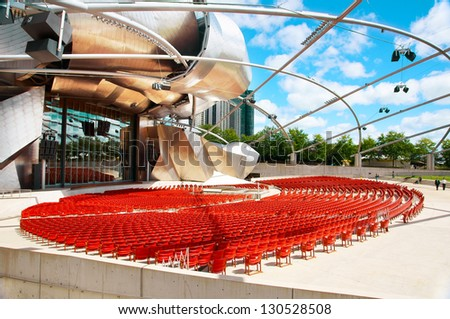 CHICAGO, ILLINOIS - SEPTEMBER 06: Jay Pritzker Pavilion on September 06, 2012 in Chicago, Illinois. Jay Pritzker Pavilion is a revolutionary space, site of outdoor concerts, designed by Frank Gehry. - stock photo