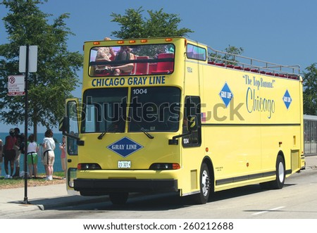 CHICAGO,ILLINOIS,USA-AUGUST 3:Chicago Gray Line Tour Bus and Tourists by the Lake Michigan in front of Adler Planetarium.August 3,2007 in Chicago,Illinois,USA. - stock photo