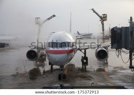 CHICAGO,ILLINOIS/USA-FEBRUARY 5TH: aircraft deicing operations on Chicago O´Hare Airport on February 5th 2014. 2014 has been one of the worst recorded winters in the Midwest.
