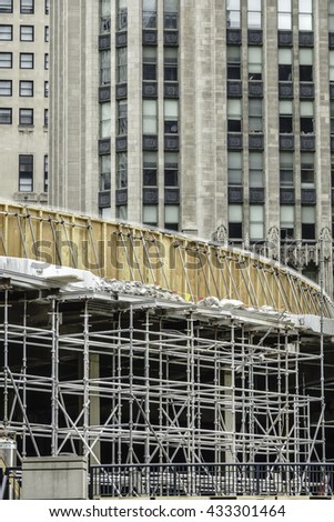 CHICAGO, ILLINOIS/USA - JUNE 4, 2016: Construction site of an Apple Inc. store between the Tribune Tower (background) and the Chicago River by the DuSable (Michigan Avenue) Bridge downtown. - stock photo