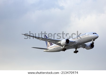 CHICAGO, ILLINOIS / USA - May 21st, 2013: Brand new United Airlines Boeing 787 Dreamliner on final approach to O'Hare International Airport during it's trial passenger flight from Houston, Texas.   - stock photo