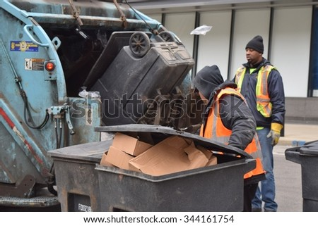 CHICAGO, ILLINOIS/USA â??OCTOBER 20, 2015: Chicago union sanitation workers remove garbage on October 20, 2015 in Chicago Loop