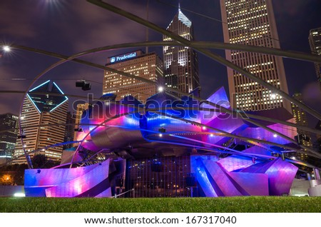 CHICAGO - JULY 19: Jay Pritzker Pavilion in Millennium Park at night on July 19, 2013 in Chicago. Outdoor Amphitheater in Downtown Chicago - stock photo