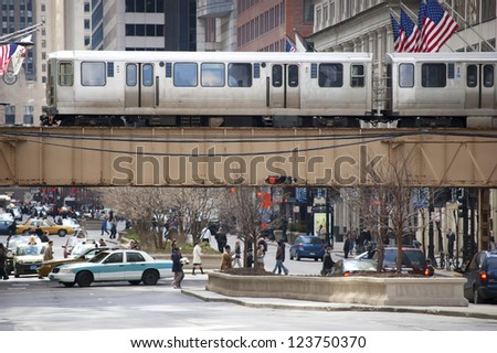 CHICAGO - JULY  14: The CTA El train crossing over State Street on July 14, 2010 in Chicago, Illinois. The Chicago Transit Authority began operations on October 1, 1947. - stock photo