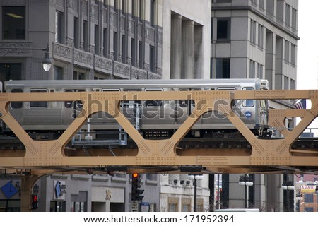 CHICAGO - JULY 14: The CTA El train crossing over the Chicago River on July 14, 2010 in Chicago, Illinois. The Chicago Transit Authority began operations on October 1, 1947. - stock photo