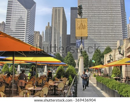 CHICAGO - JULY 21, 2007: Tourists walk along city streets. Chicago attracts more than 10 millions tourists annually. - stock photo