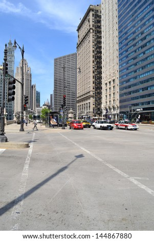 CHICAGO - JUNE 14: Cars waiting at a stop light on Wacker Drive on June 14, 2011 in Chicago, Illinois. Wacker Drive is a major east-west and north-south road inside of the Loop. - stock photo