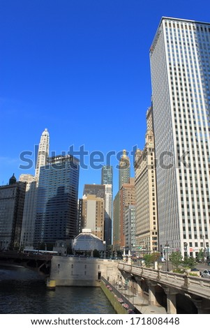 CHICAGO - JUNE 17: Classic skyscrapers near the Chicago River on June 17, 2012 in Chicago, Illinois. The Windy City is the third largest city in the U.S. and is a worldwide center of commerce.  - stock photo