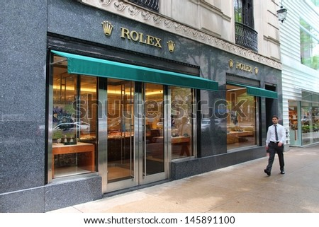 CHICAGO - JUNE 26: Man walks past Rolex store on June 26, 2013 in Chicago. Rolex is a valuable luxury brand. It exists since 1905 and had US$ 5.1bn revenue in 2010.