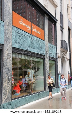 CHICAGO - JUNE 26: People walk past Tommy Bahama store at Magnificent Mile on June 26, 2013 in Chicago. The Magnificent Mile is one of most prestigious shopping districts in the United States. - stock photo