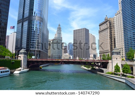 CHICAGO - JUNE 14: The Chicago River on June 14, 2011 in Chicago, Illinois. The Chicago River serves as the main link between the Great Lakes and the Mississippi Valley waterways. - stock photo