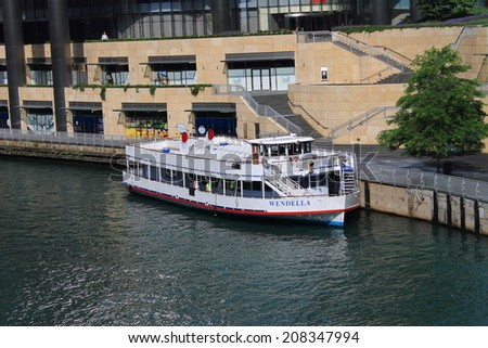 """CHICAGO - June 18: Wendella sightseeing boat on June 18, 2012 in Chicago, Illinois. The company advertises its river tours as """"Chicago's Original Architecture Tour.""""  - stock photo"""