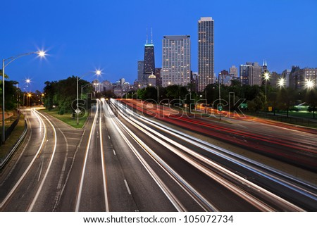 Chicago Lake Shore Drive. Image of the busy Lake Shore Drive in Chicago downtown during twilight blue hour. - stock photo