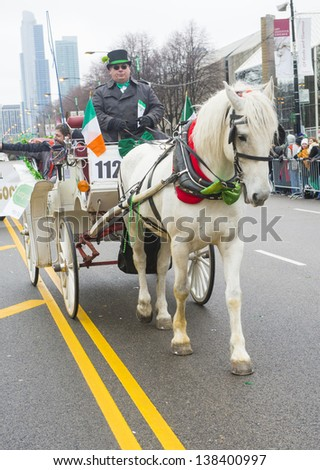 CHICAGO - MARCH 16 : Participants with Horse and cart at the annual Saint Patrick's Day Parade in Chicago on March 16 2013