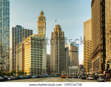 CHICAGO - MAY 18: Downtown Chicago with  the Wrigley building on May 18, 2013 in Chicago, IL. The Wrigley Building is a skyscraper located directly across Michigan Avenue on the Magnificent Mile. - stock photo