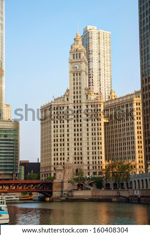CHICAGO - MAY 18: Downtown Chicago with the Wrigley building on May 18, 2013 in Chicago, IL. The Wrigley Building is a skyscraper located directly across Michigan Avenue from the Tribune Tower. - stock photo