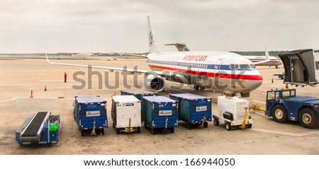 Chicago November 12: Pushback tractor driver preparing American Airline plane at O'hare Airport , on June 10, 2013. O'Hare International Airport resides on over 7,000 acres and is 2nd busiest airport. - stock photo