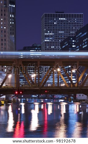 Chicago River at Night - Old Metal Lake Street Bridge. Downtown Chicago, Illinois, USA. - stock photo