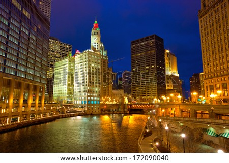 Chicago River Walk with street lights and water reflections at dusk, IL, USA - stock photo