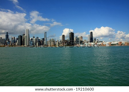 Chicago's skyline and Navy Pier from Lake Michigan, with clear blue skies - stock photo