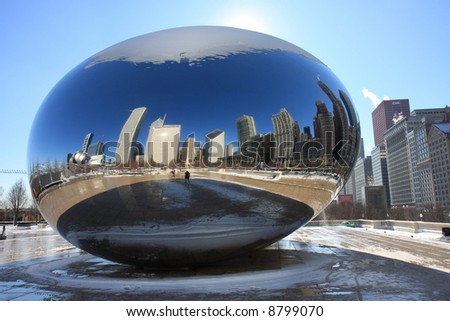 Chicago's Skyline Reflects off Cloud Gate in Millennium Park - stock photo