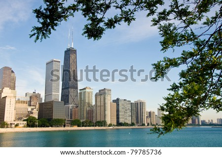 Chicago's skyline shot from Navy Pier framed by trees - stock photo