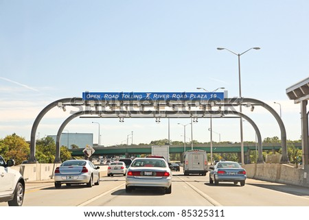 Chicago-Sept 21: Traffic stalls on Highway 90 during rush hour at the River Road Toll plaza on September 21, 2011, in Chicago Illinois.  Illinois was the first state to convert to Open Road Tolling. - stock photo