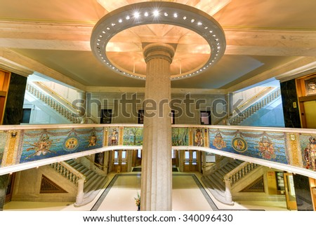 Chicago - September 6, 2015: The Marquette Building completed in 1895 is a Chicago landmark. The mosaics, sculptures and bronze of the entry and interior honors Jacques Marquetteâs 1674-5 expedition. - stock photo