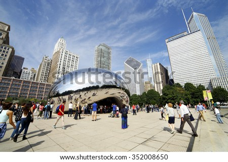 CHICAGO - SEPTEMBER 09: The mirrored sculpture popularly known as the Bean (Cloud Gate, by Anish Kapoor), has become one of Chicago's most popular attractions, as seen on September 09, 2014.  - stock photo