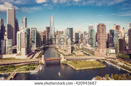 Chicago Skyline aerial view with boat on the river , vintage colors