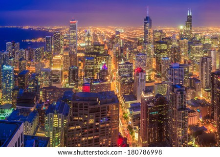 Chicago skyline aerial view with skyscrapers over Lake Michigan at dusk. - stock photo