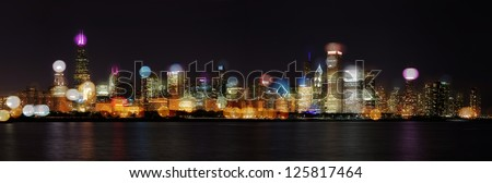 Chicago Skyline at Night- Skyline with blurred photo bokeh composited on top - stock photo
