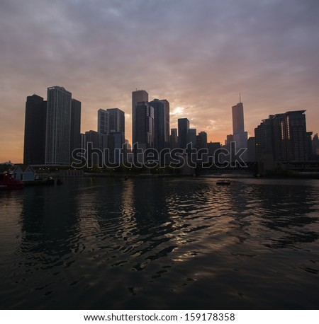 Chicago Skyline from Boat at Sunset - stock photo