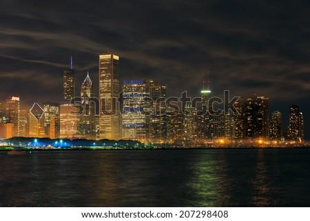 Chicago Skyline Mirrored over Lake Michigan  - stock photo
