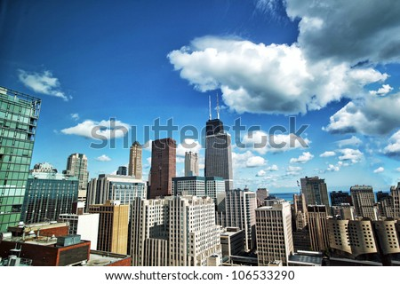 Chicago skyline on sunny blue sky day with clouds - stock photo